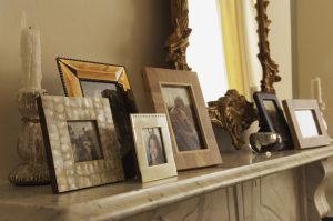framed photos on mantle in sepia tones