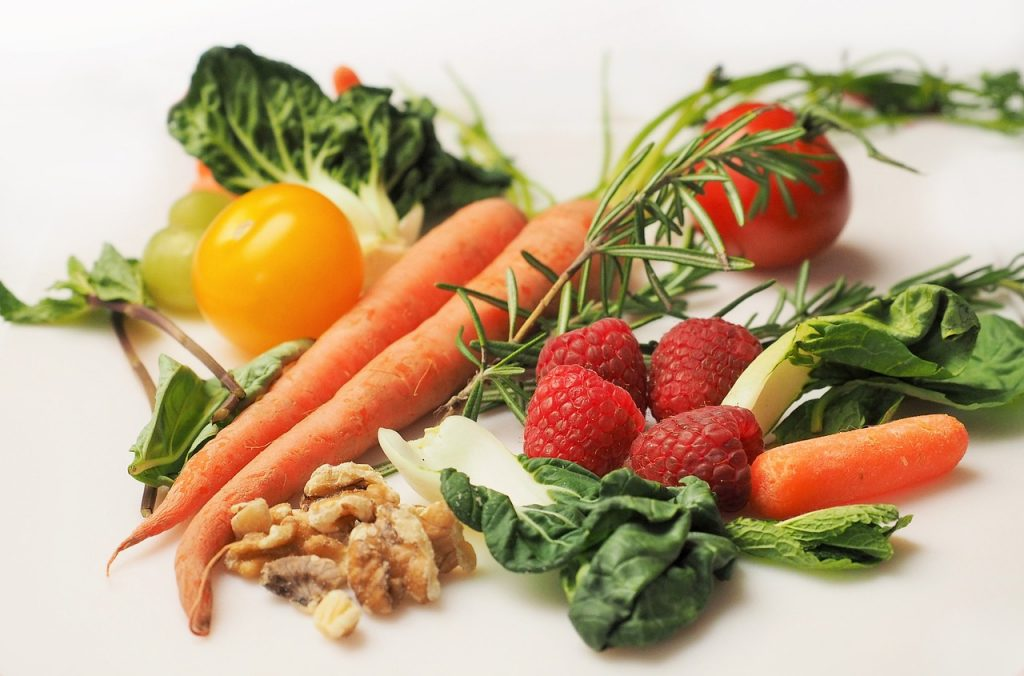 photo of berries, vegetables, greens, and nuts
