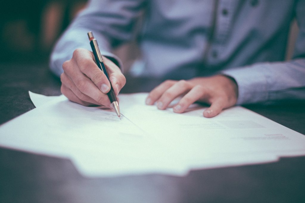 man signing a living will